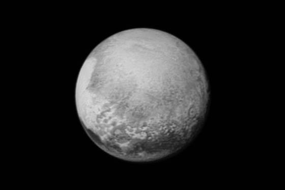 "Pluto's bright, mysterious ""heart"" is rotating into view, ready for its close-up on close approach, in this image taken by New Horizons on Sunday from a distance of 1.6 million miles (2.5 million kilometers). NASA / JHUAPL / SwRI"